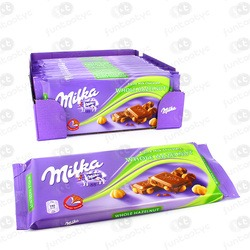CHOCOLATE MILKA AVELÃS INTEIRAS